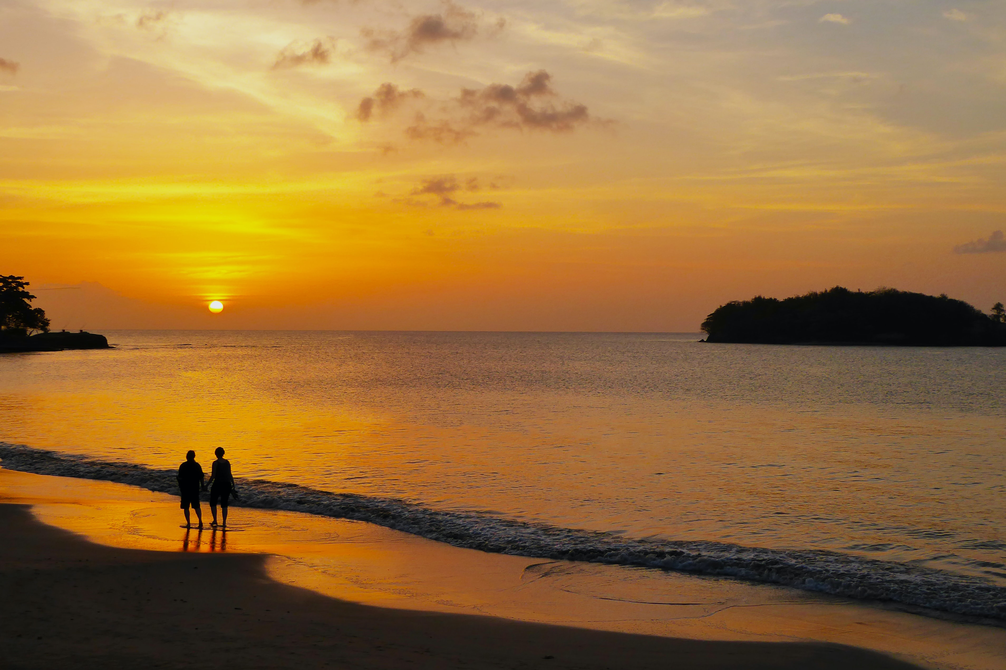 two person on beach during sunset