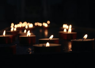 photo of lighted tealight candles