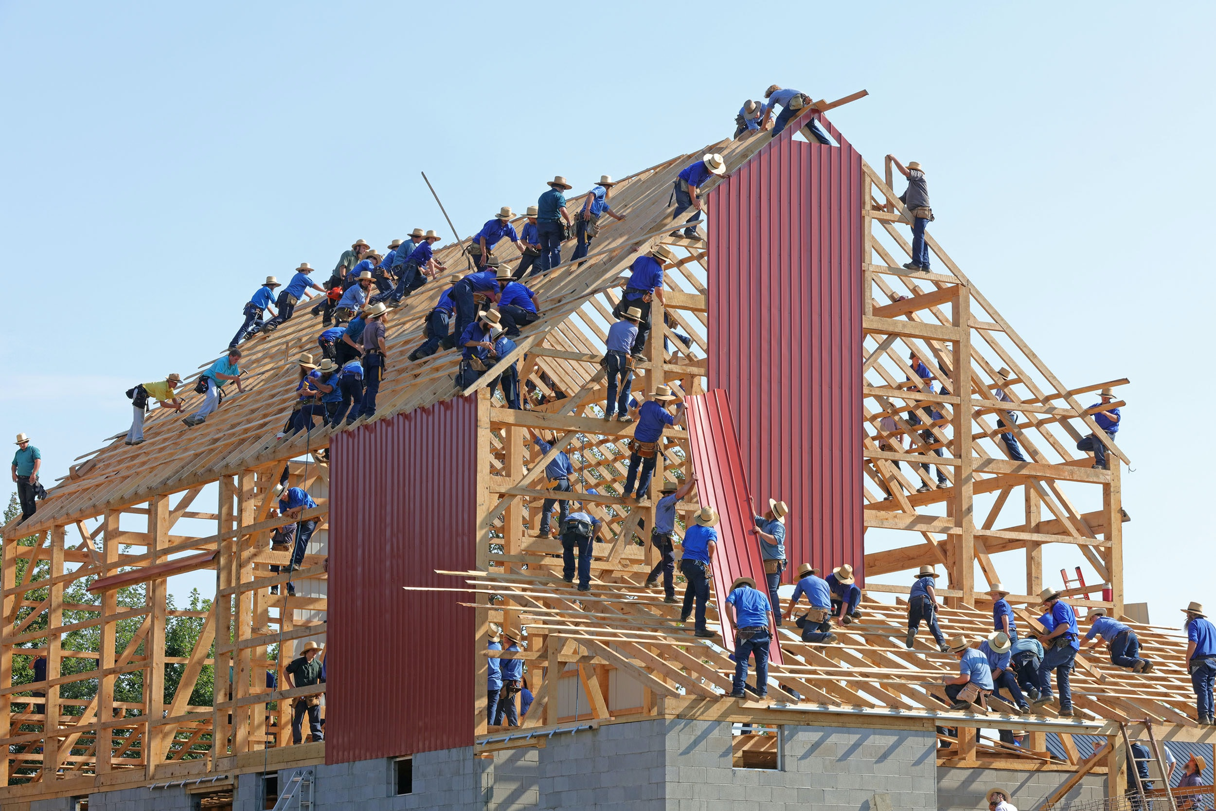 people building structure during daytime