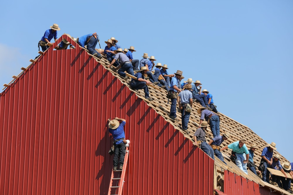 group of construction workers constructing house