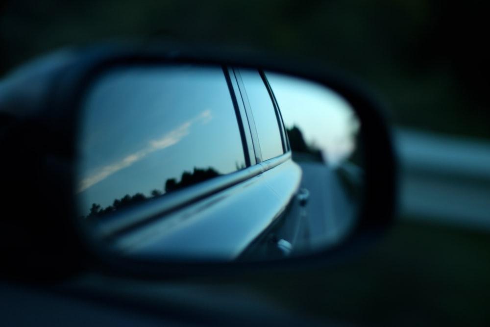 black car through wing mirror