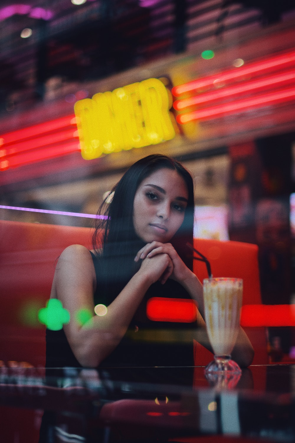 woman in front of shake in pilsner glass