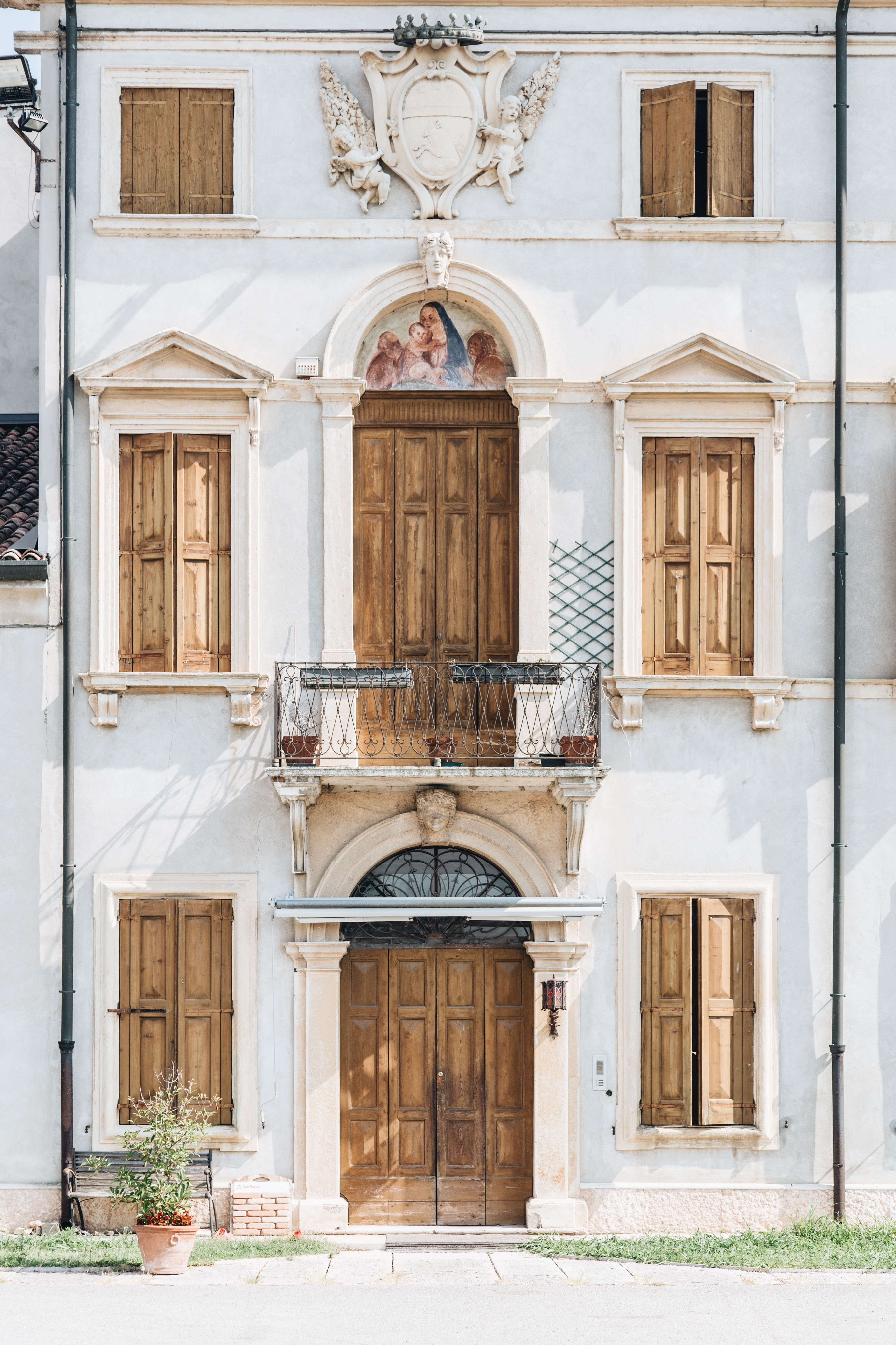 white concrete building with wooden doors and windows