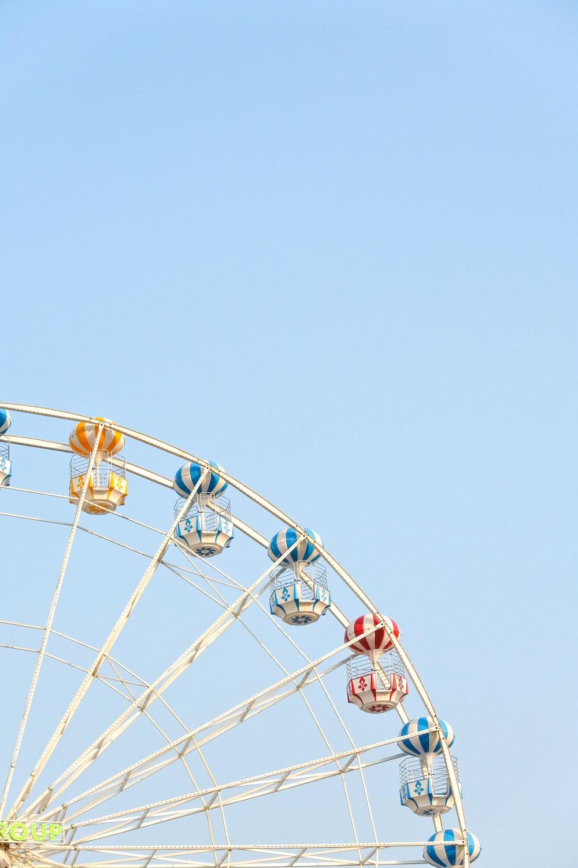 worm's eye view of Ferris Wheel under clear blue sky