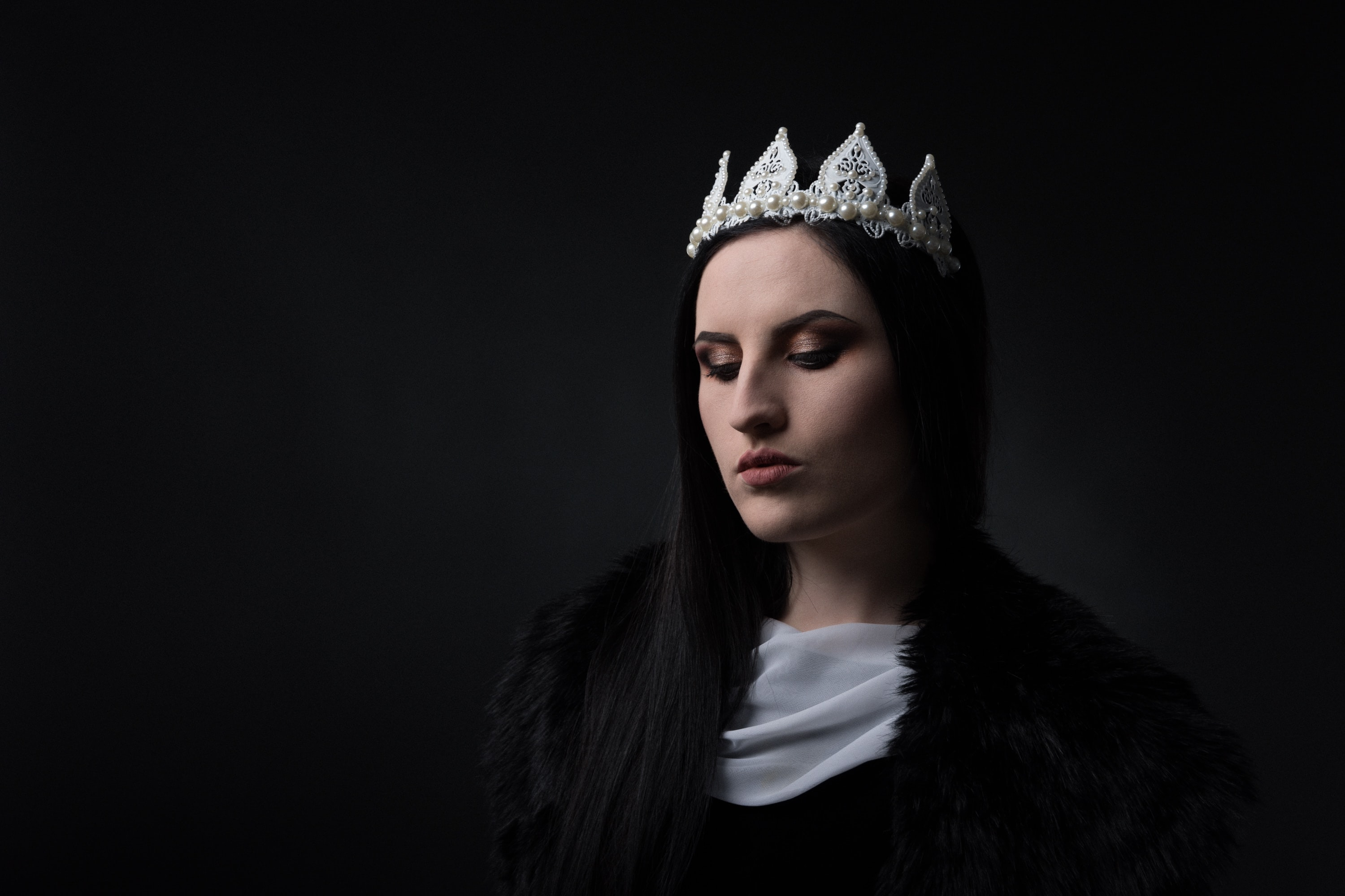 women wearing crown with eyes closed