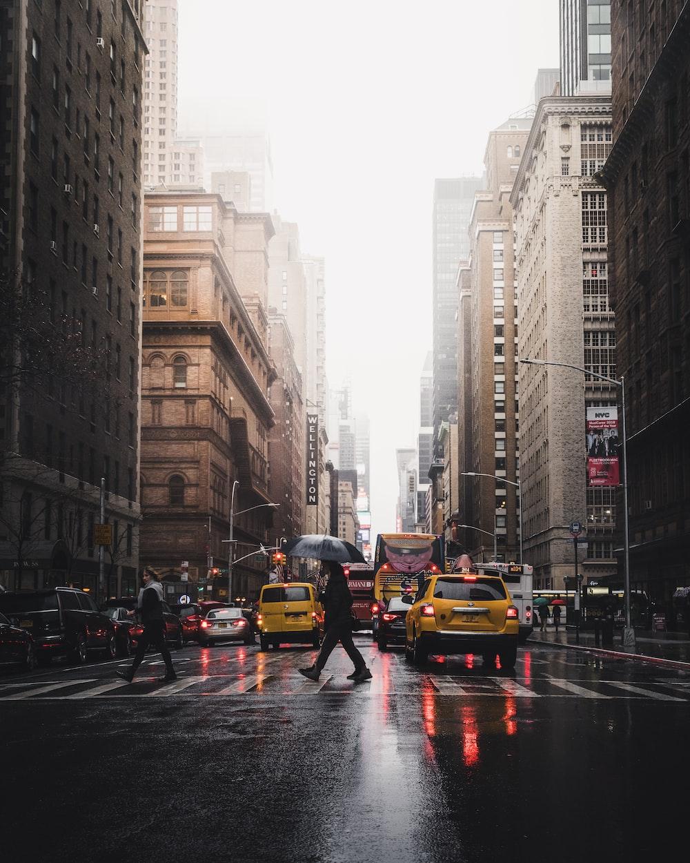 person walking on pedestrian lane between buildings