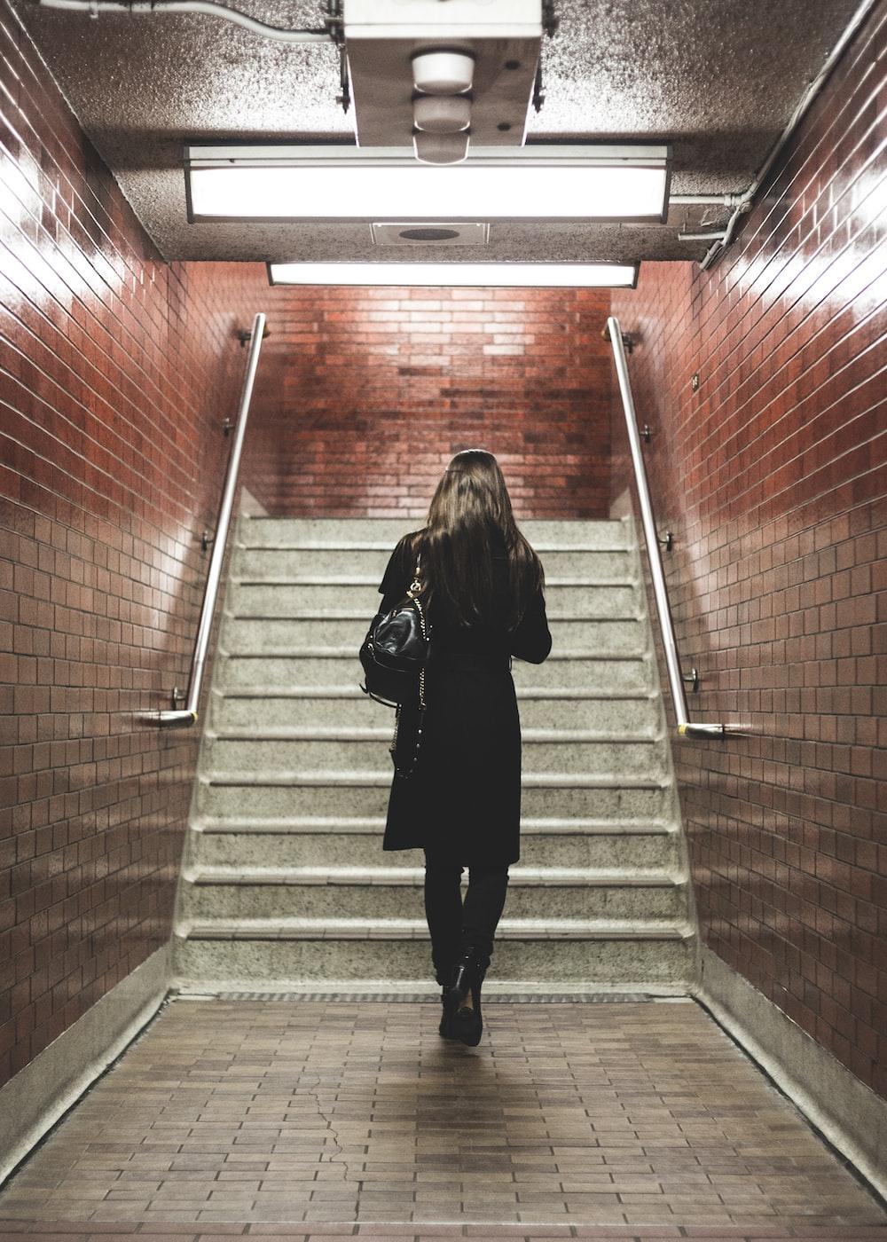 woman walking near staircase