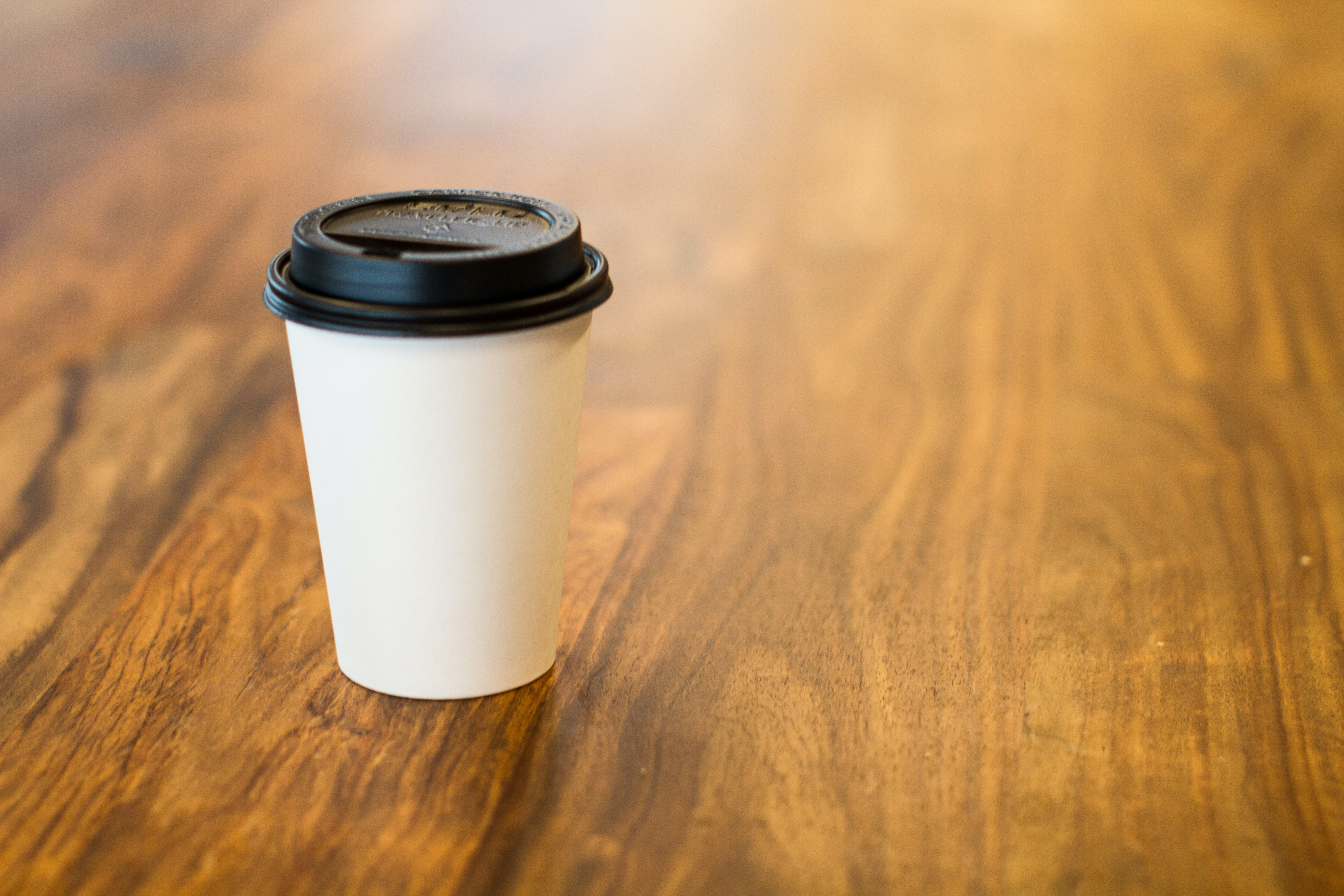 white and black plastic cup