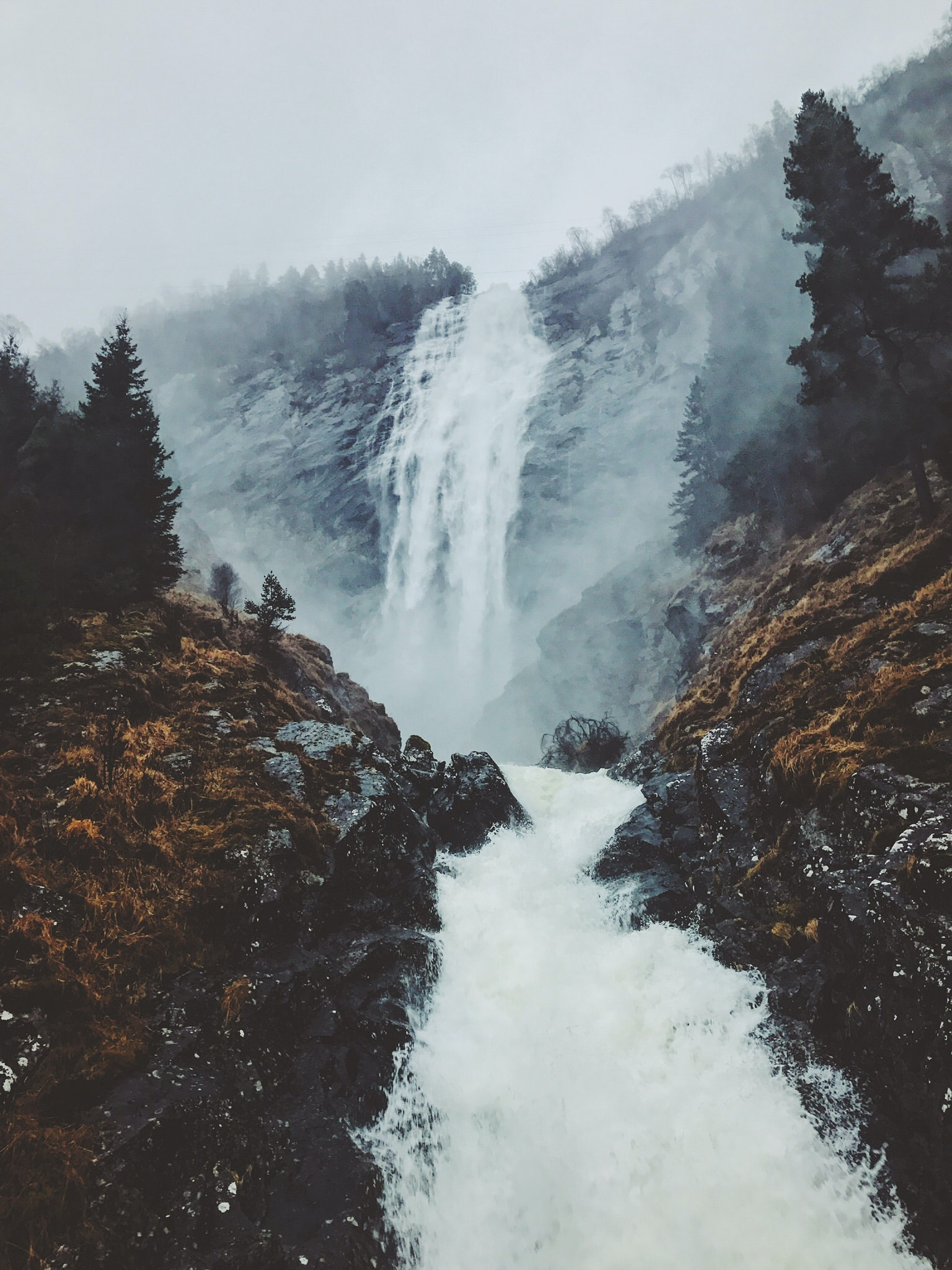 foggy mountain with falls
