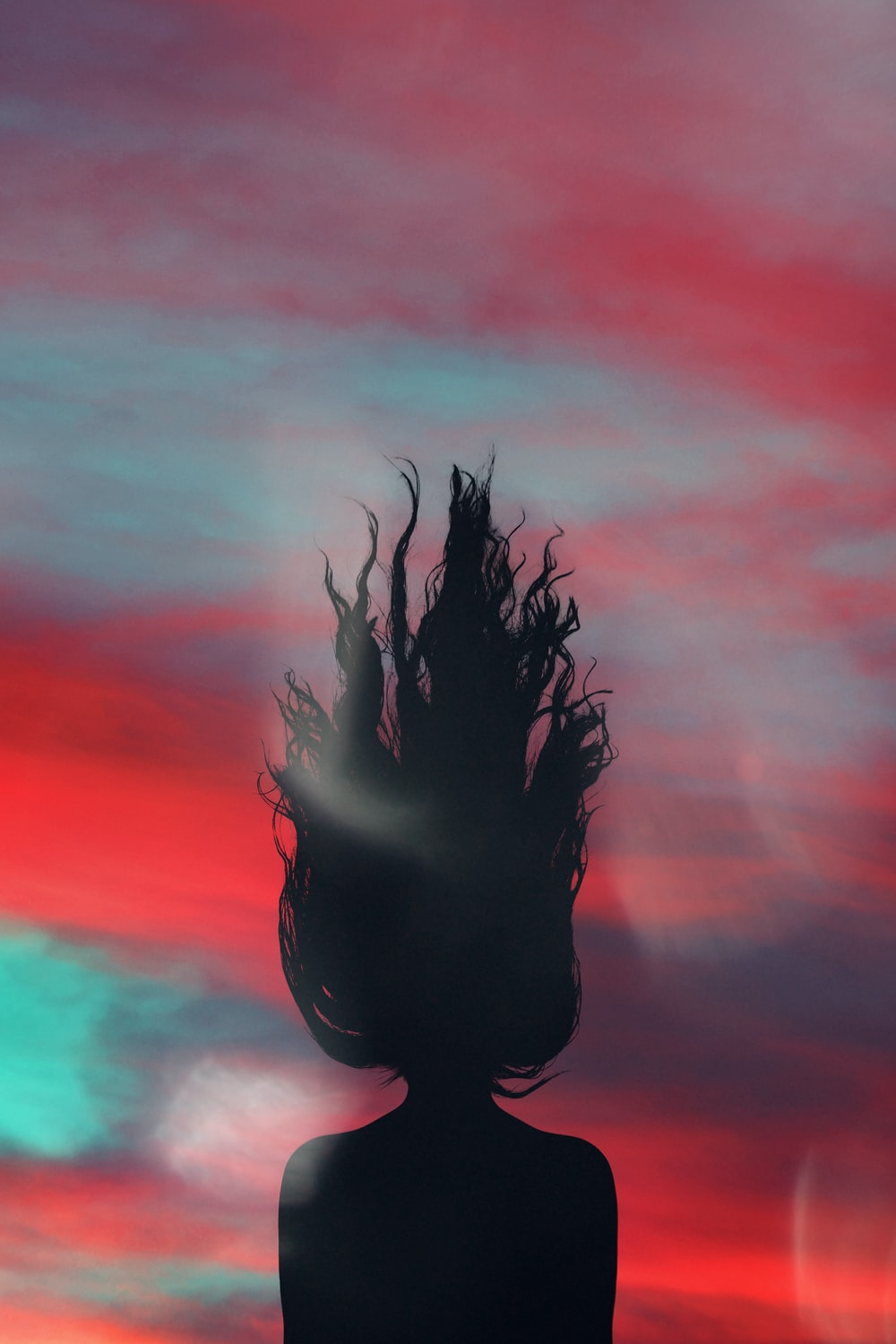 silhouette of woman facing on sky