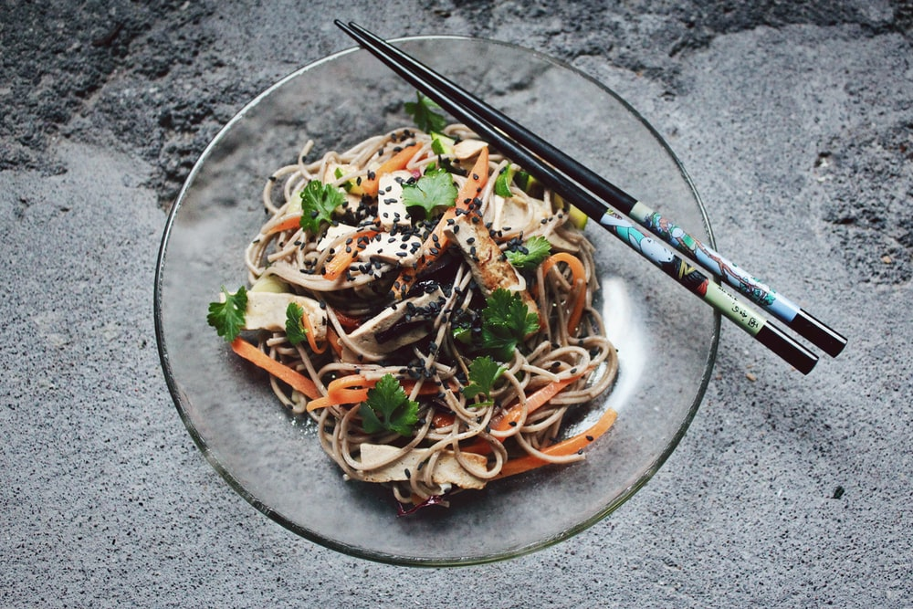 vegetable noodle with chopstick on glass plate