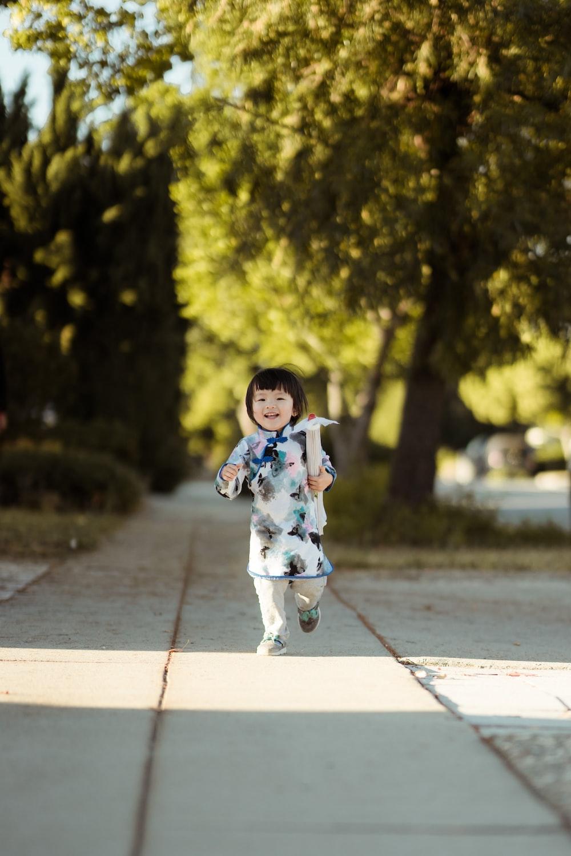 girl walks on gray concrete pathway