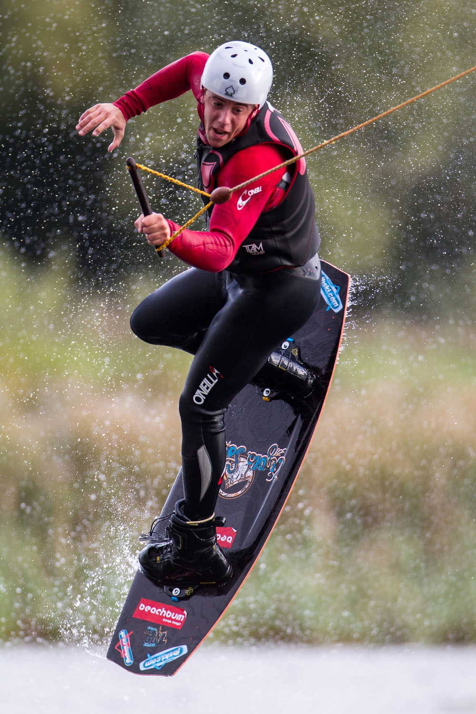 man surf boarding on body of water