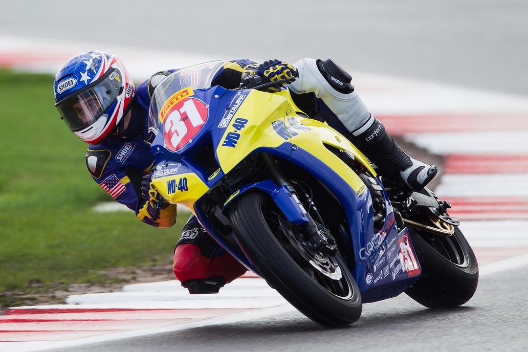 WD-40 Rider no. 31 on a bend at Silverstone