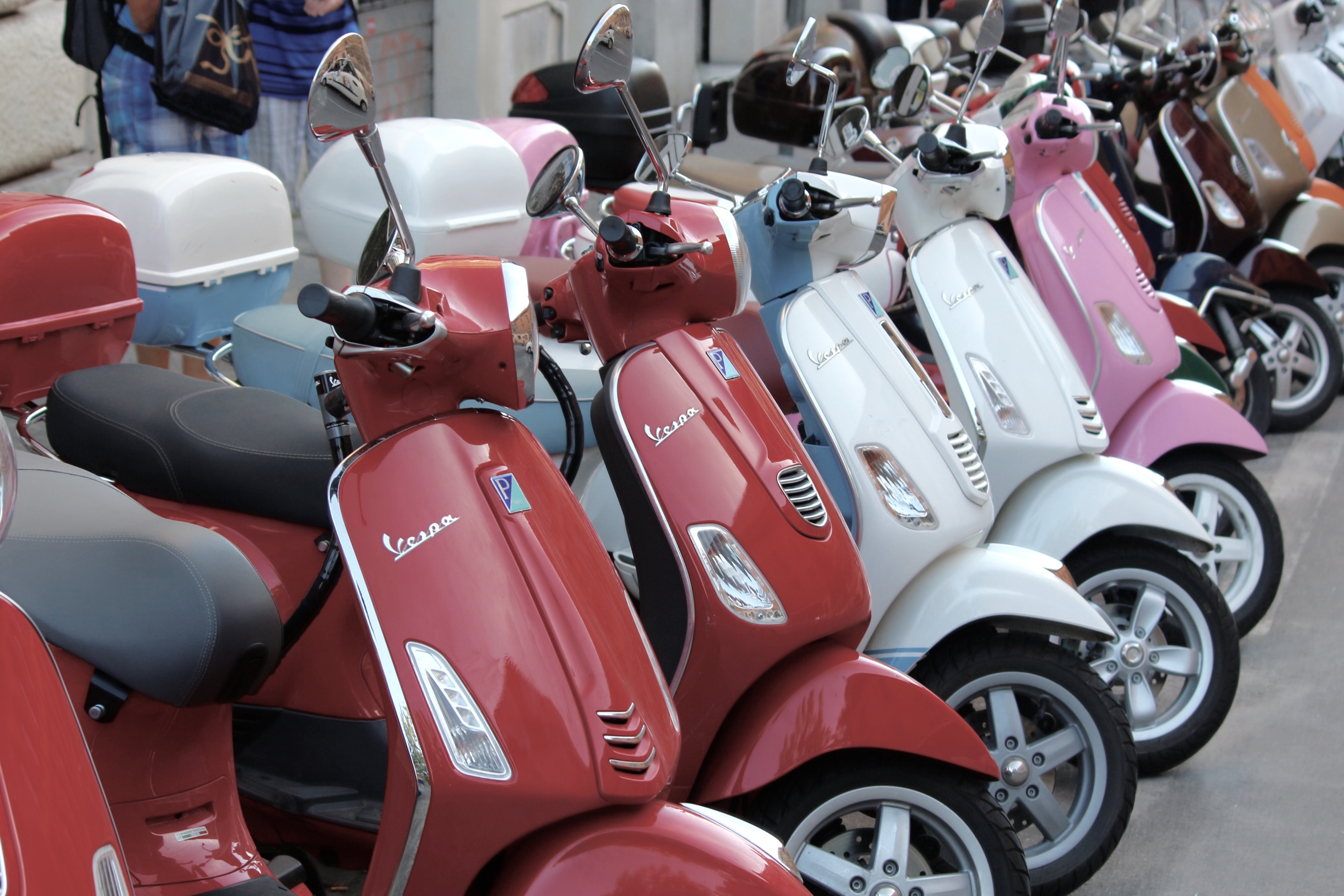 red, white, and pink automatic scooters