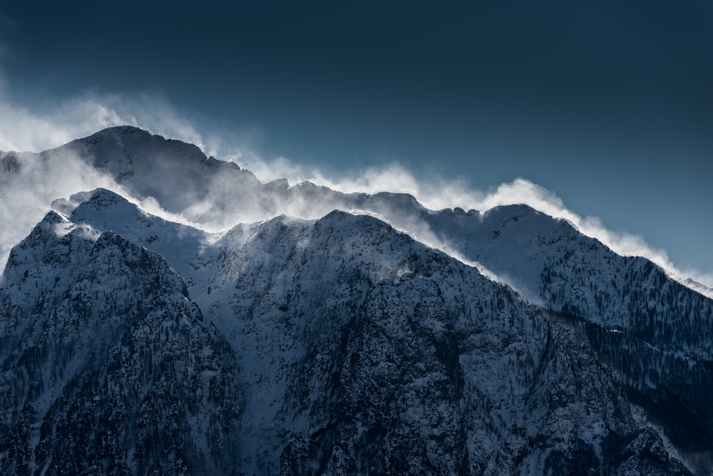 snow-covered mountains under clear sky during daytime