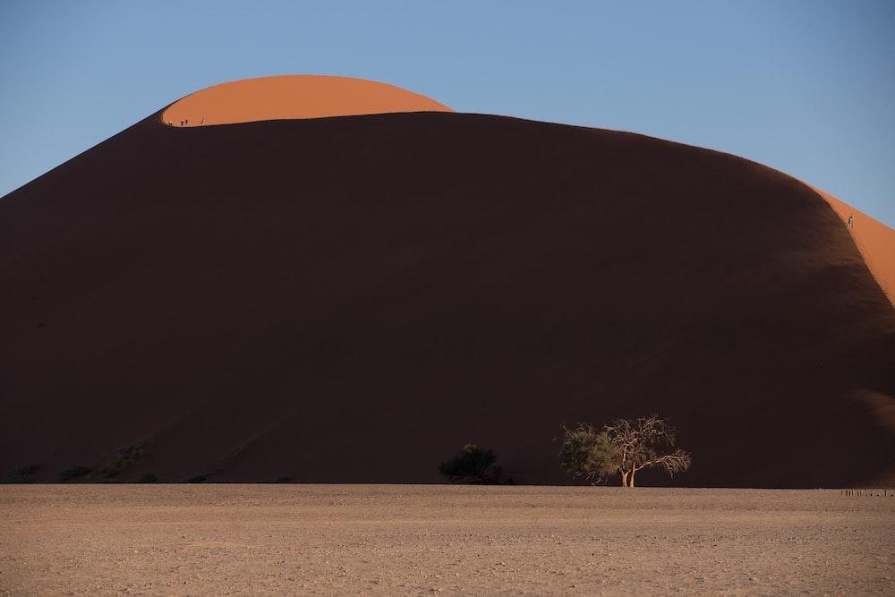 brown sand near mountain at daytime