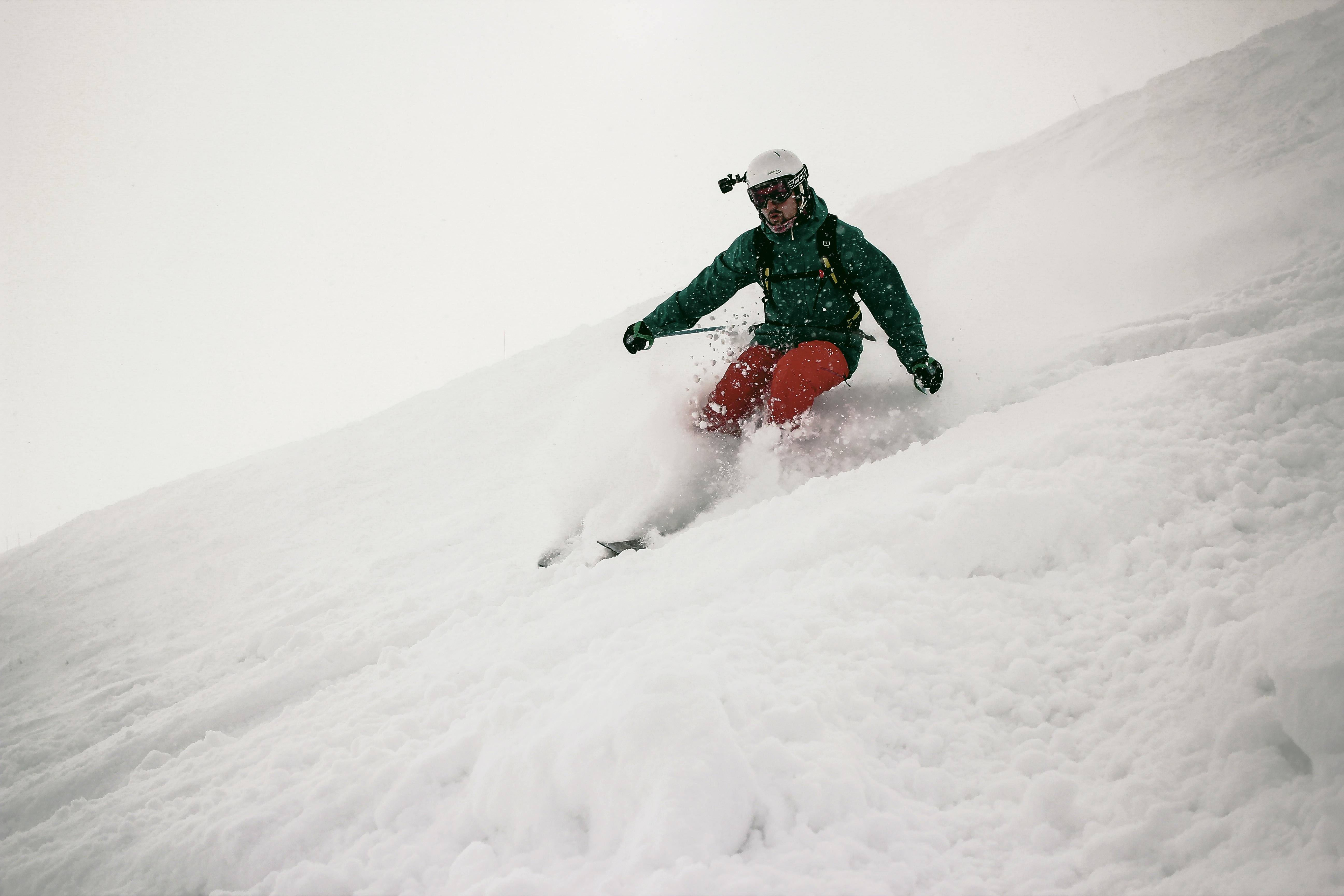 man playing snowboard