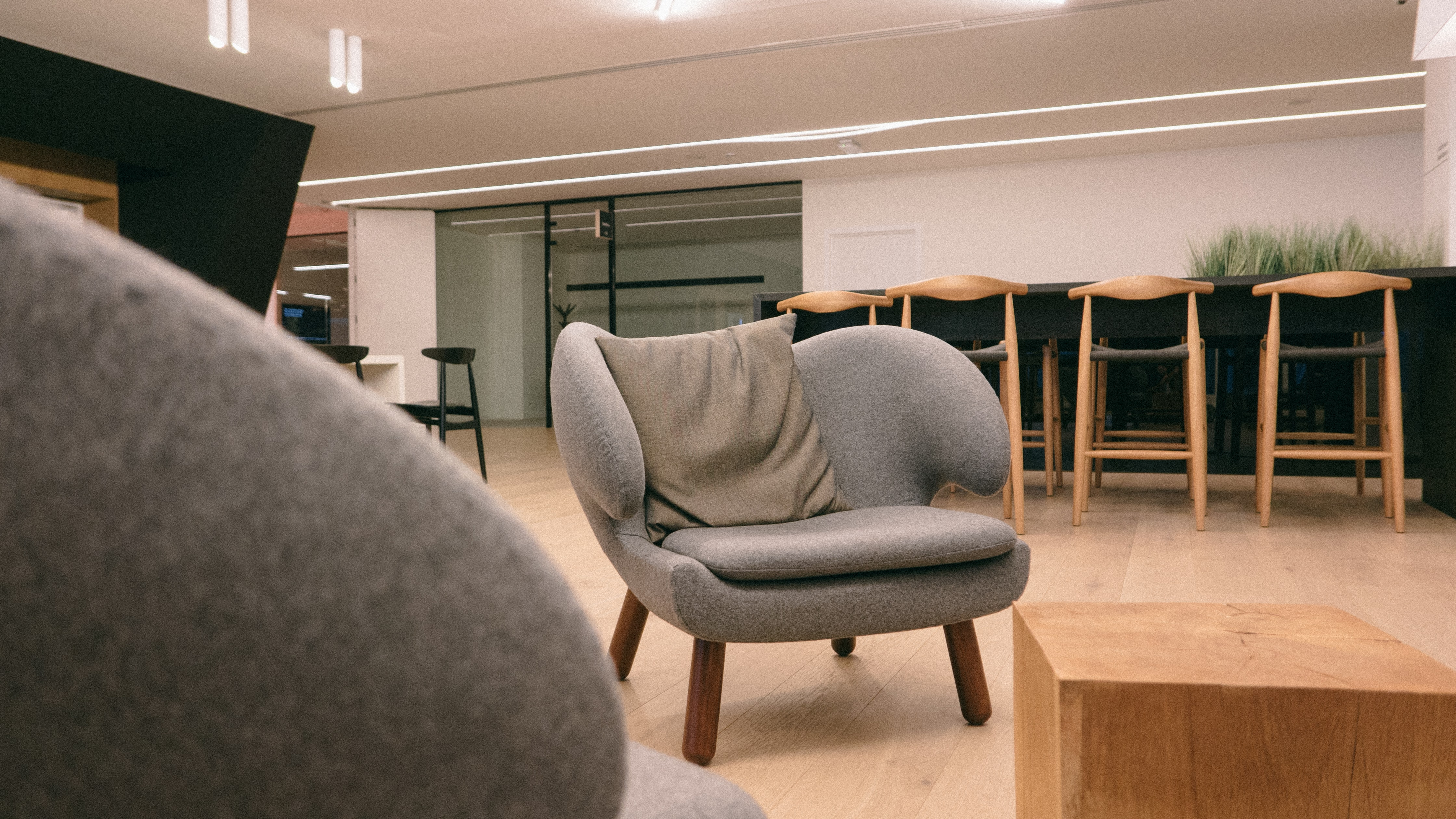photo of gray fabric padded sofa chair near brown wooden coffee table in room