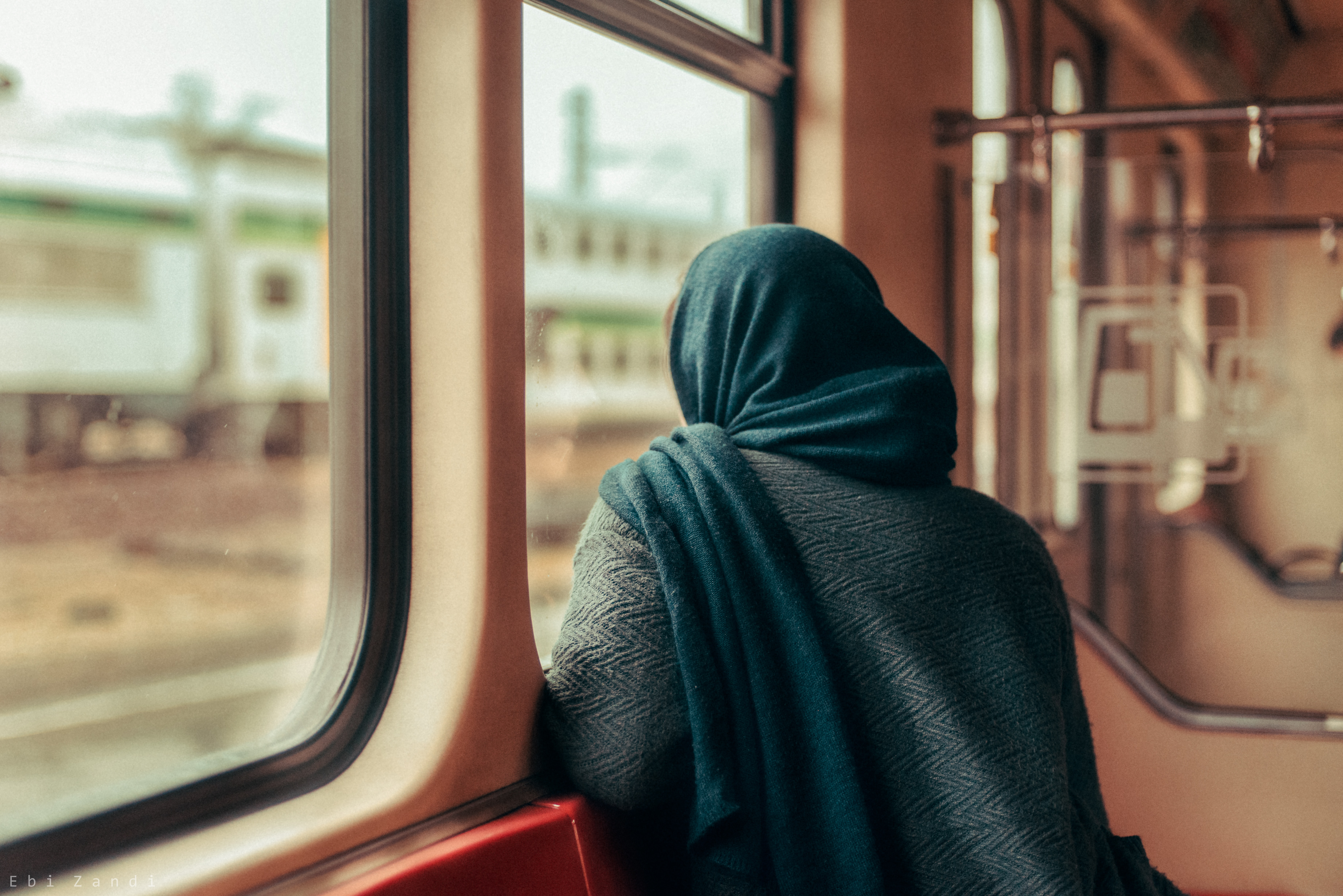 woman looking outside the window
