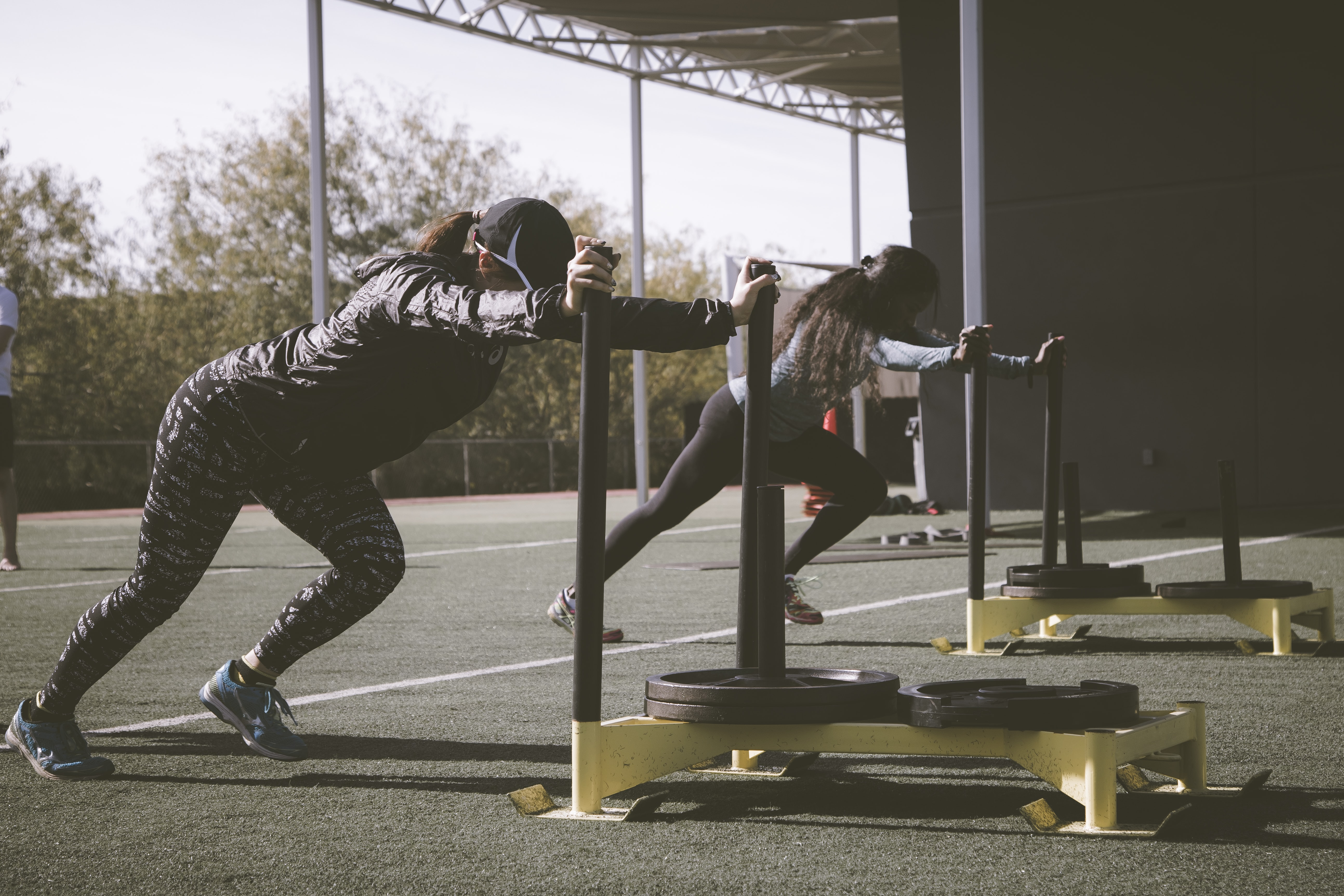 two women doing gym activity during daytime