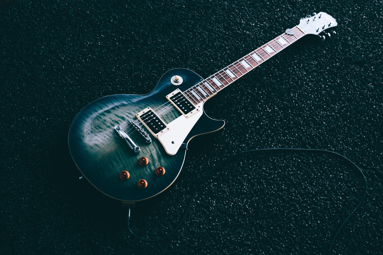 black whiskered single-cutaway electric guitar