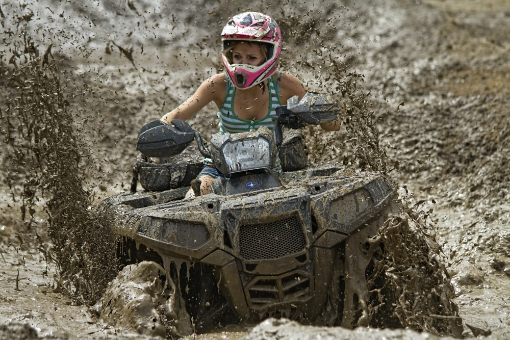 woman riding on off-road ATV