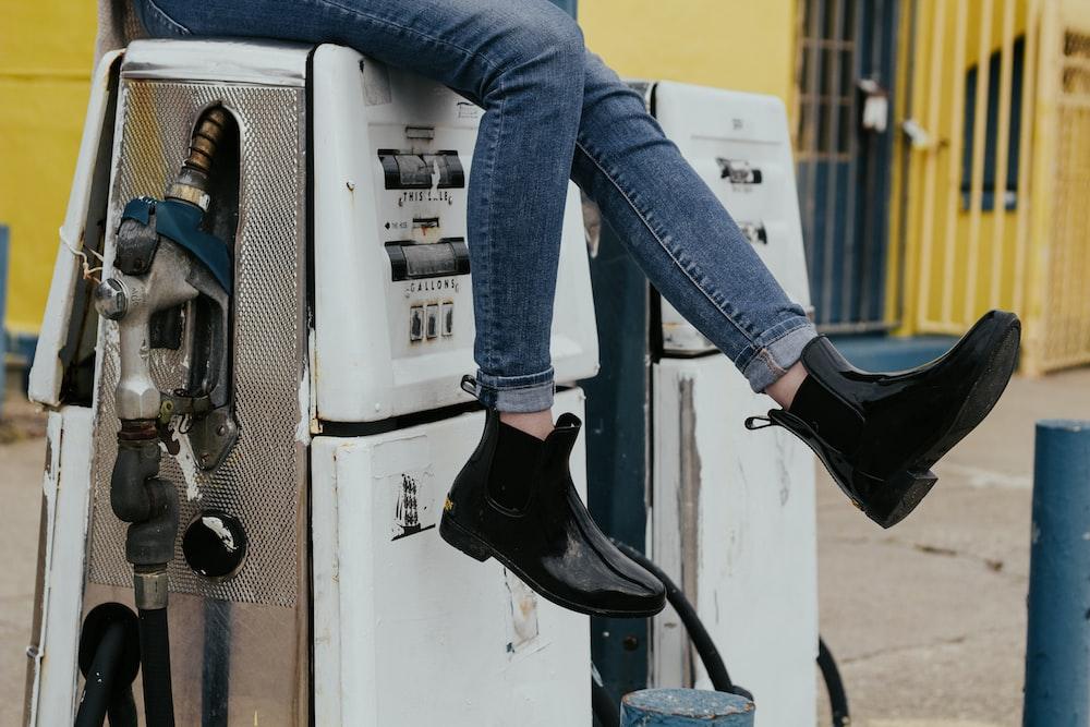 woman sitting on fuel tank