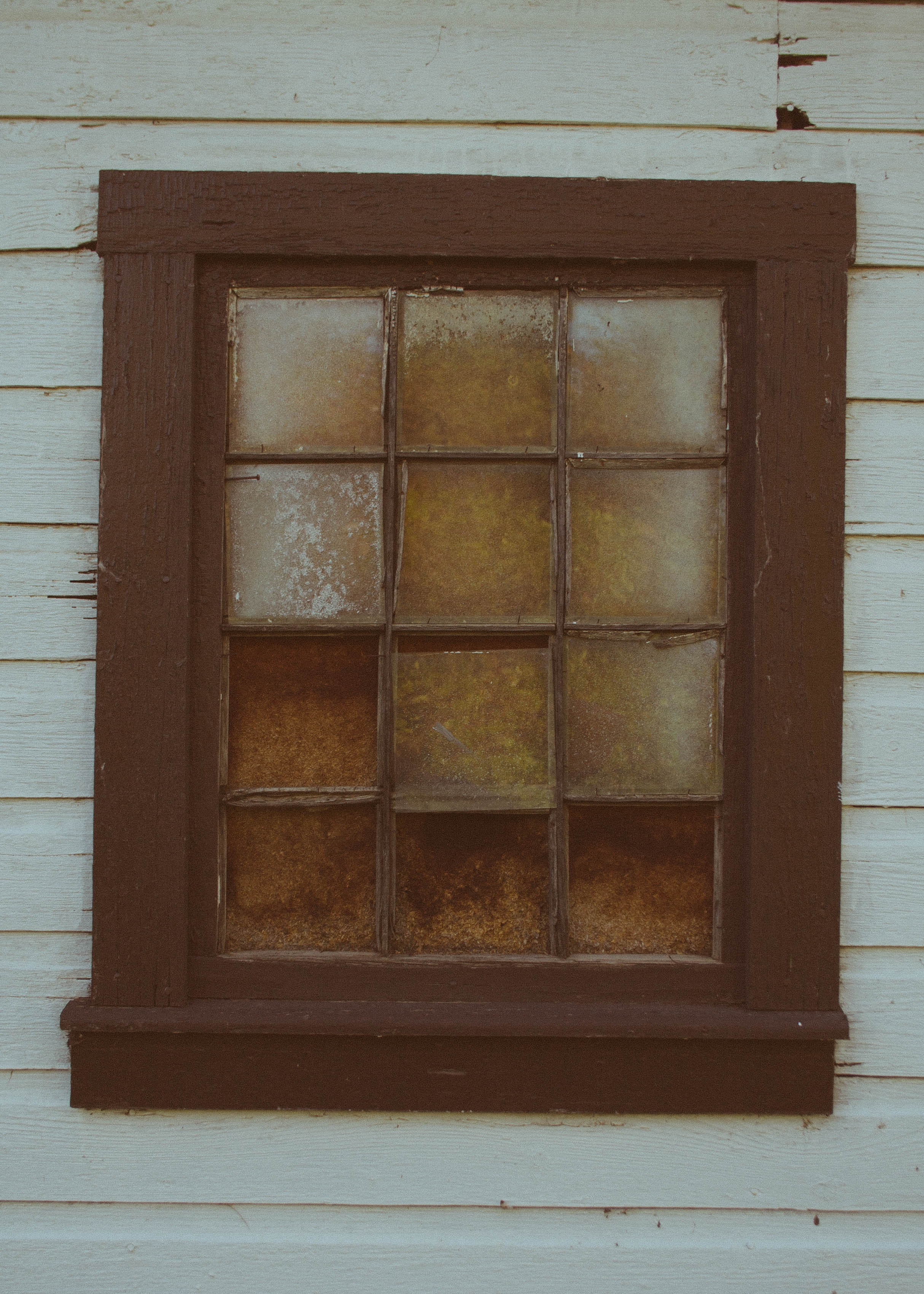 close up photo of square brown wooden window