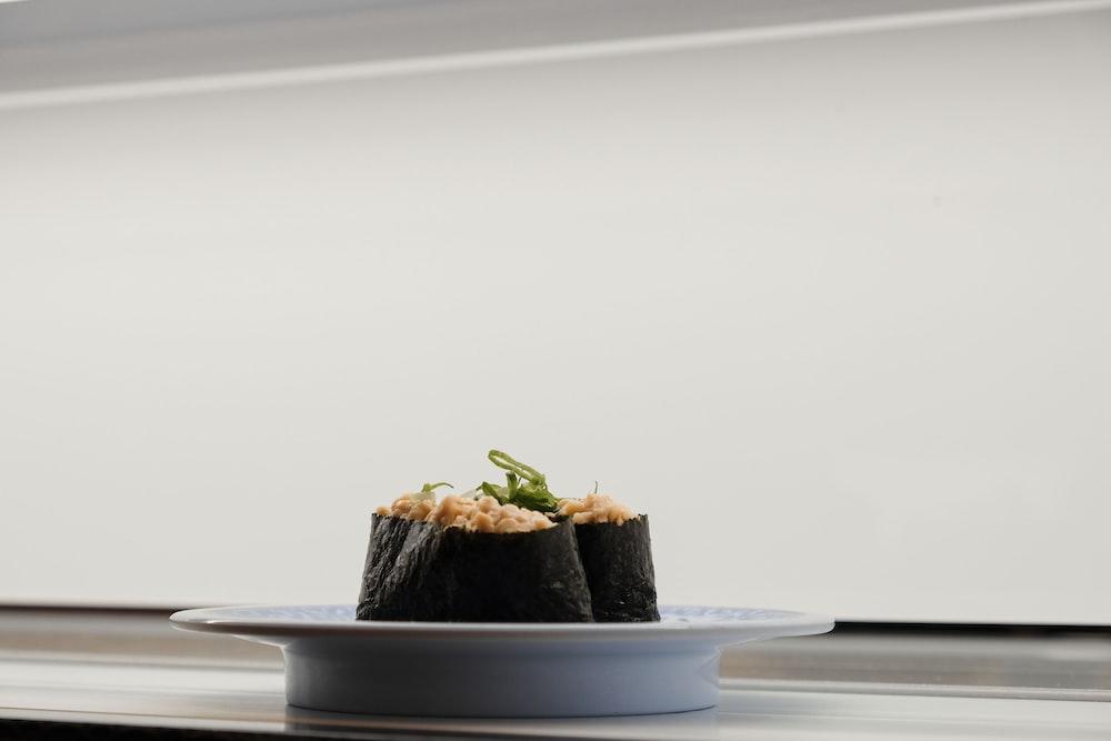 sushi served on white ceramic saucer