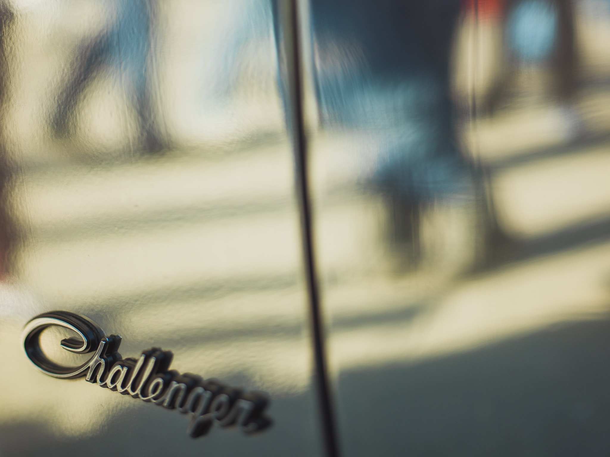 shallow focus photography of silver Challenger emblem