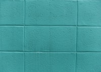 teal painted concrete wall