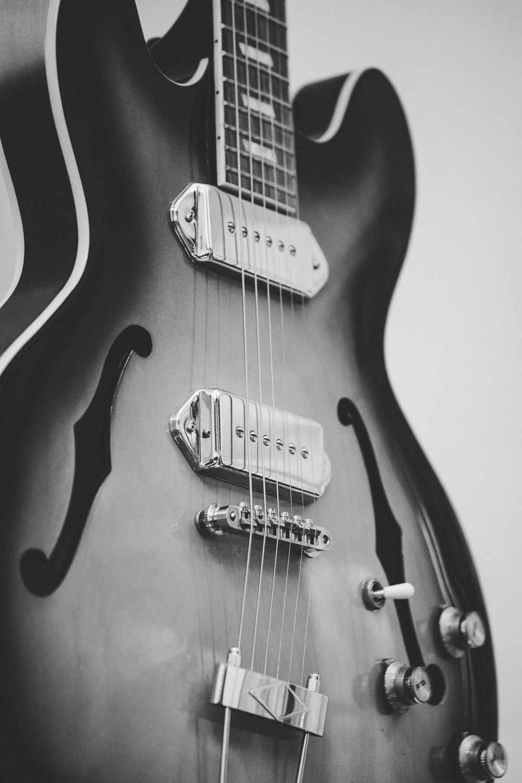 greyscale photo of jazz guitar