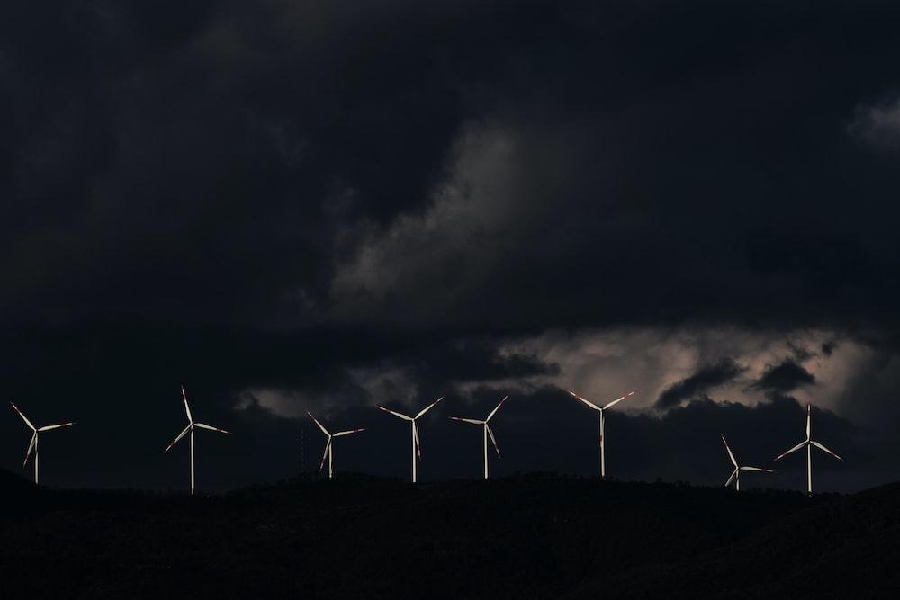 eight white wind turbines