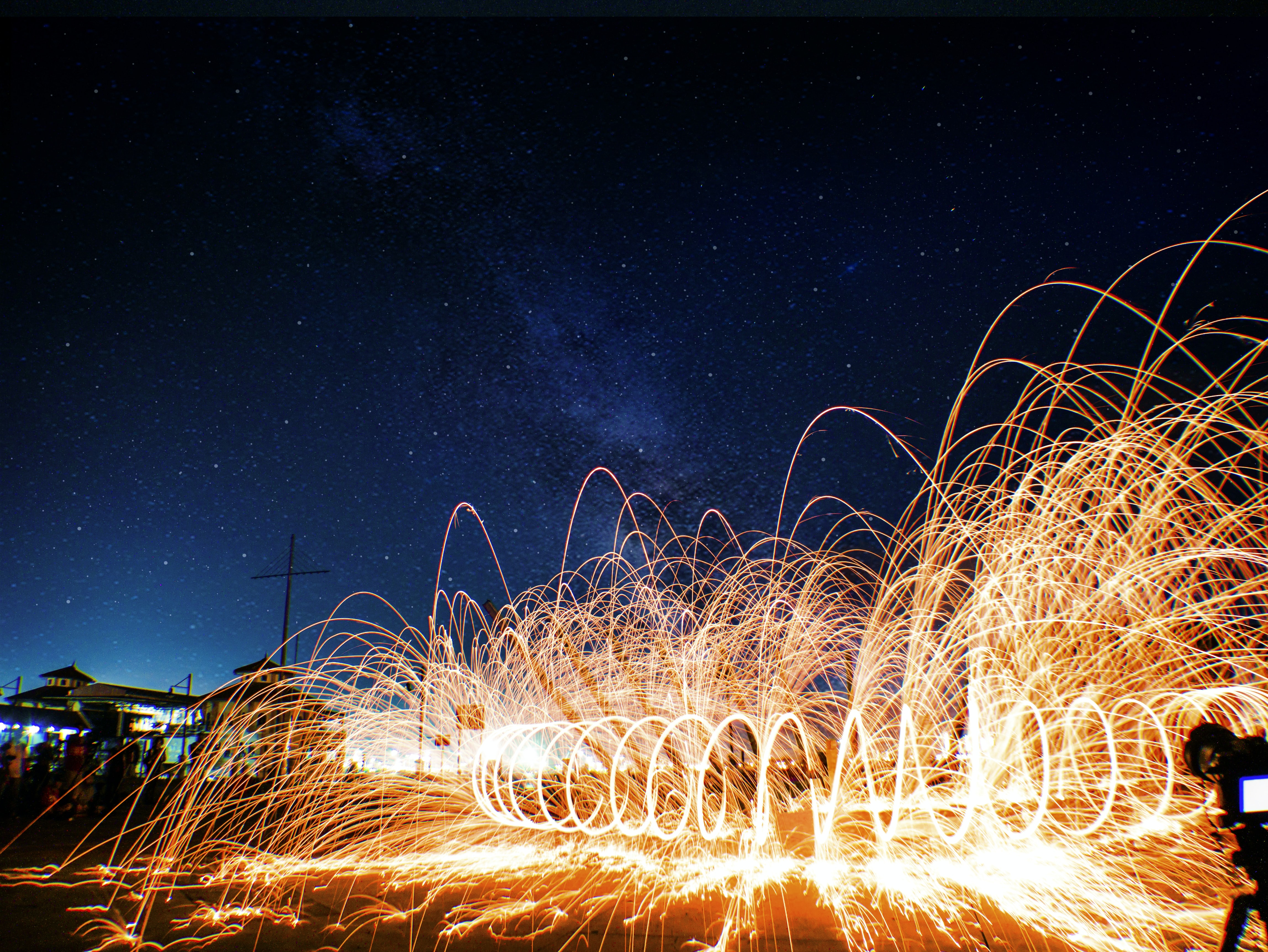 steel wool photography of spiral orange light at nighttime
