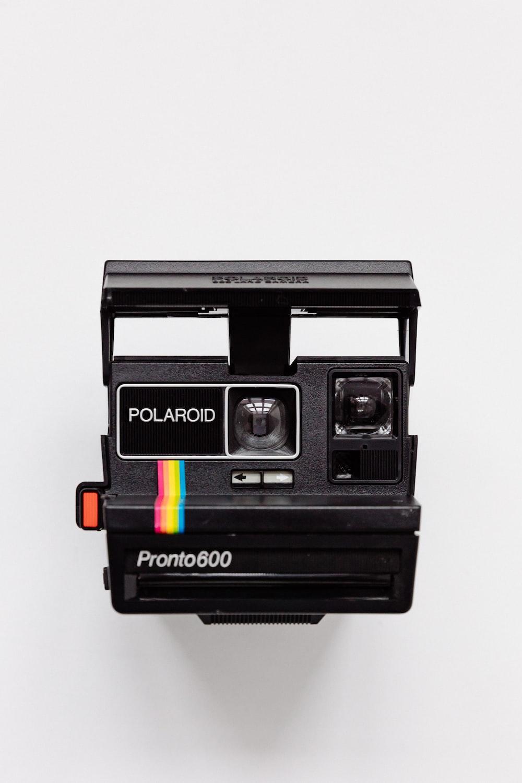 black Polaroid camera with white background