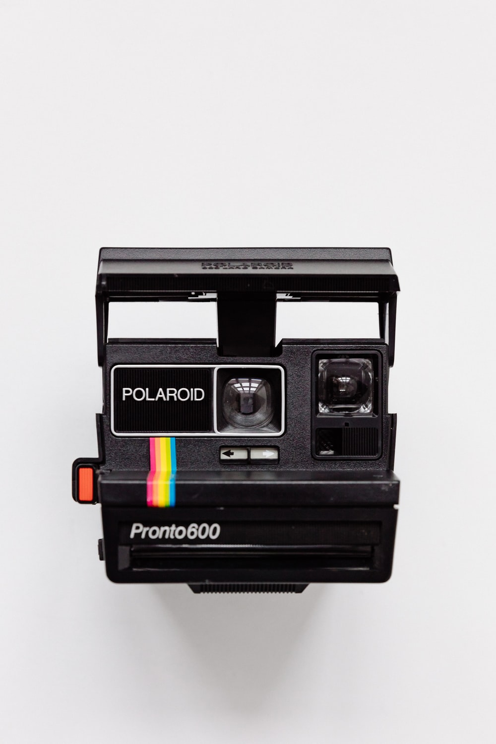 black Polaroid camera with white background