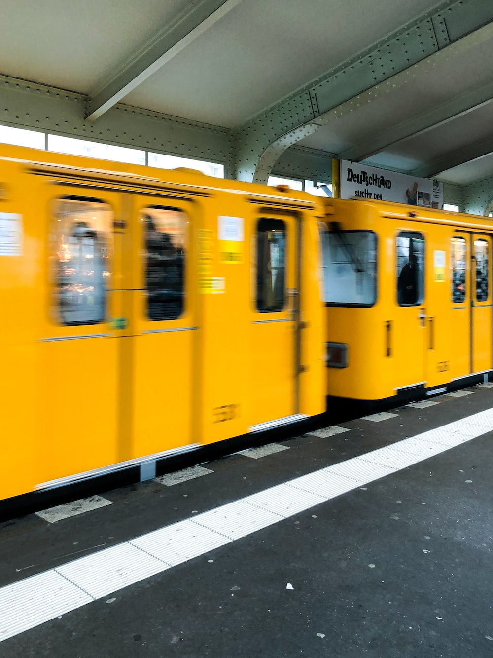 yellow train on train station during daytime