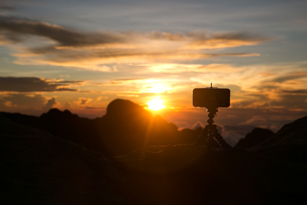 silhouette of camera with gorrila pod during sunset