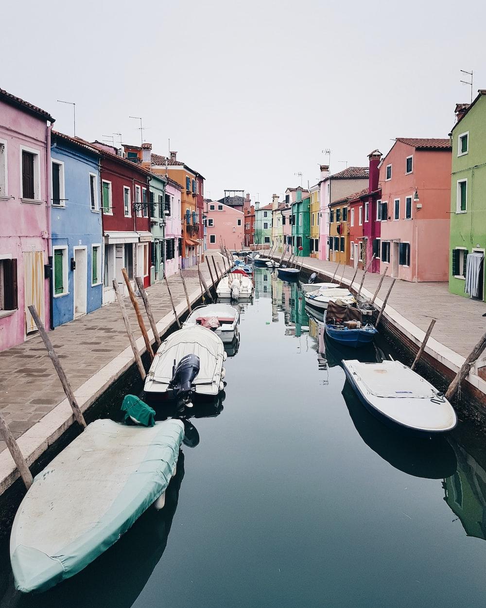 fishing boats between houses