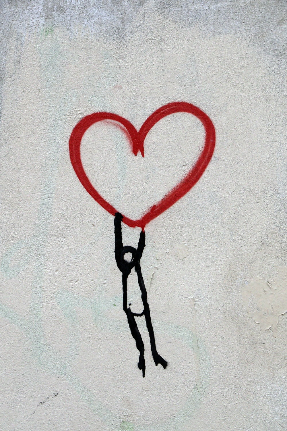 red heart and man hanging drawing