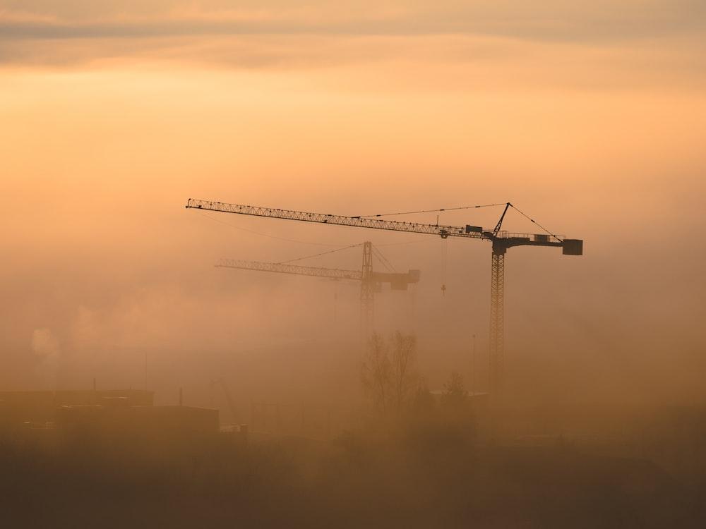 black and grey metal crane photography