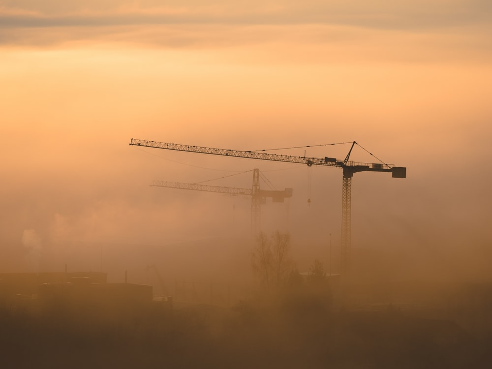 black and grey metal crane photography