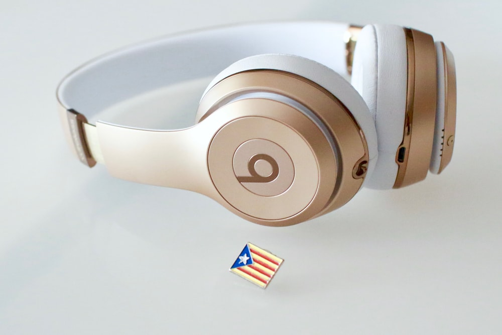 gold and white Beats headfphones