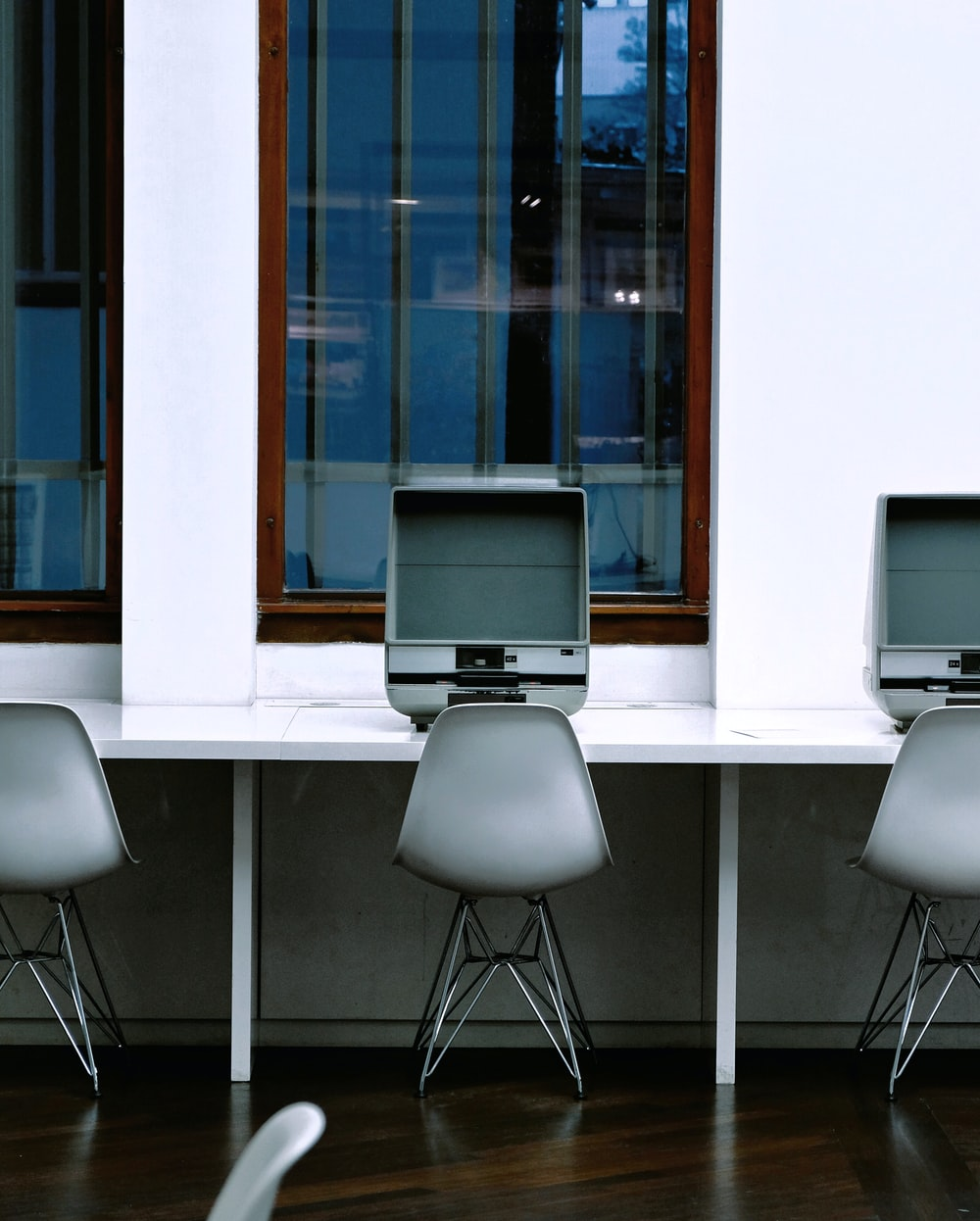 gray flat screen monitor on white wooden desk