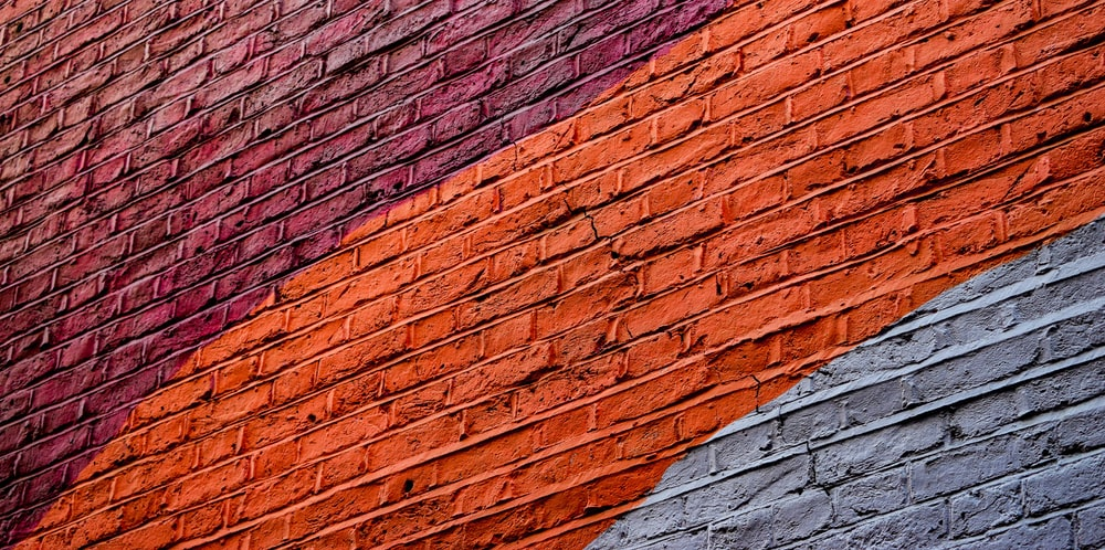 low angle photography of concrete building with assorted-color paint