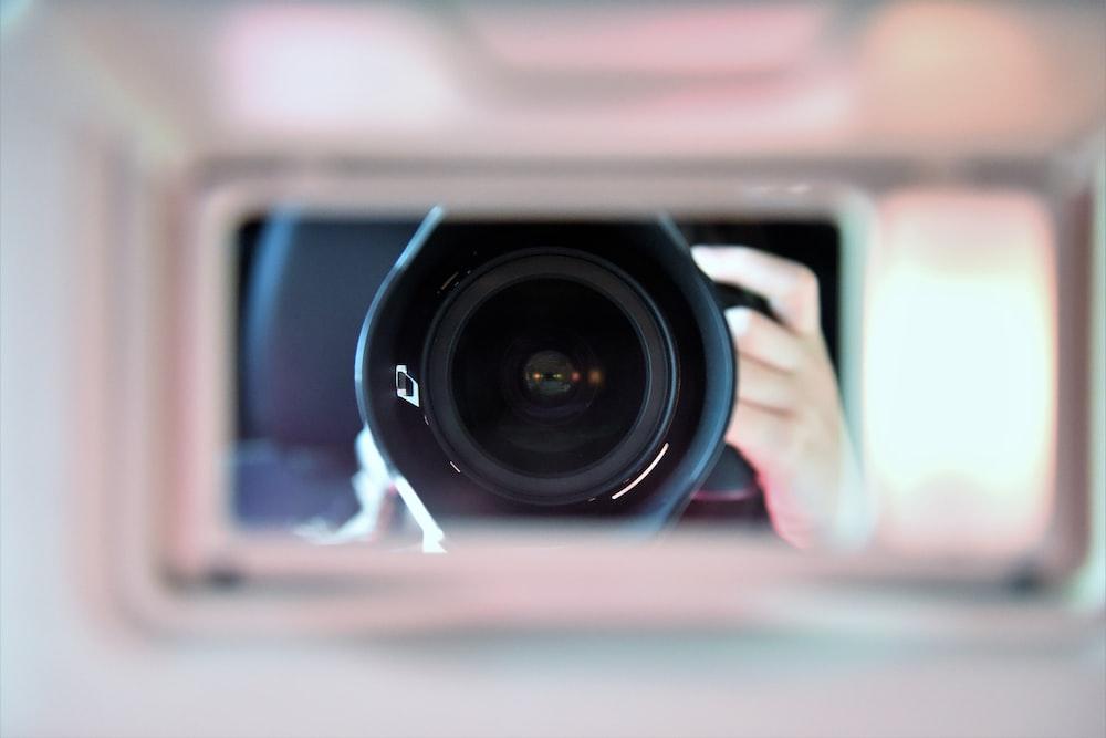shallow focus photography of camera len