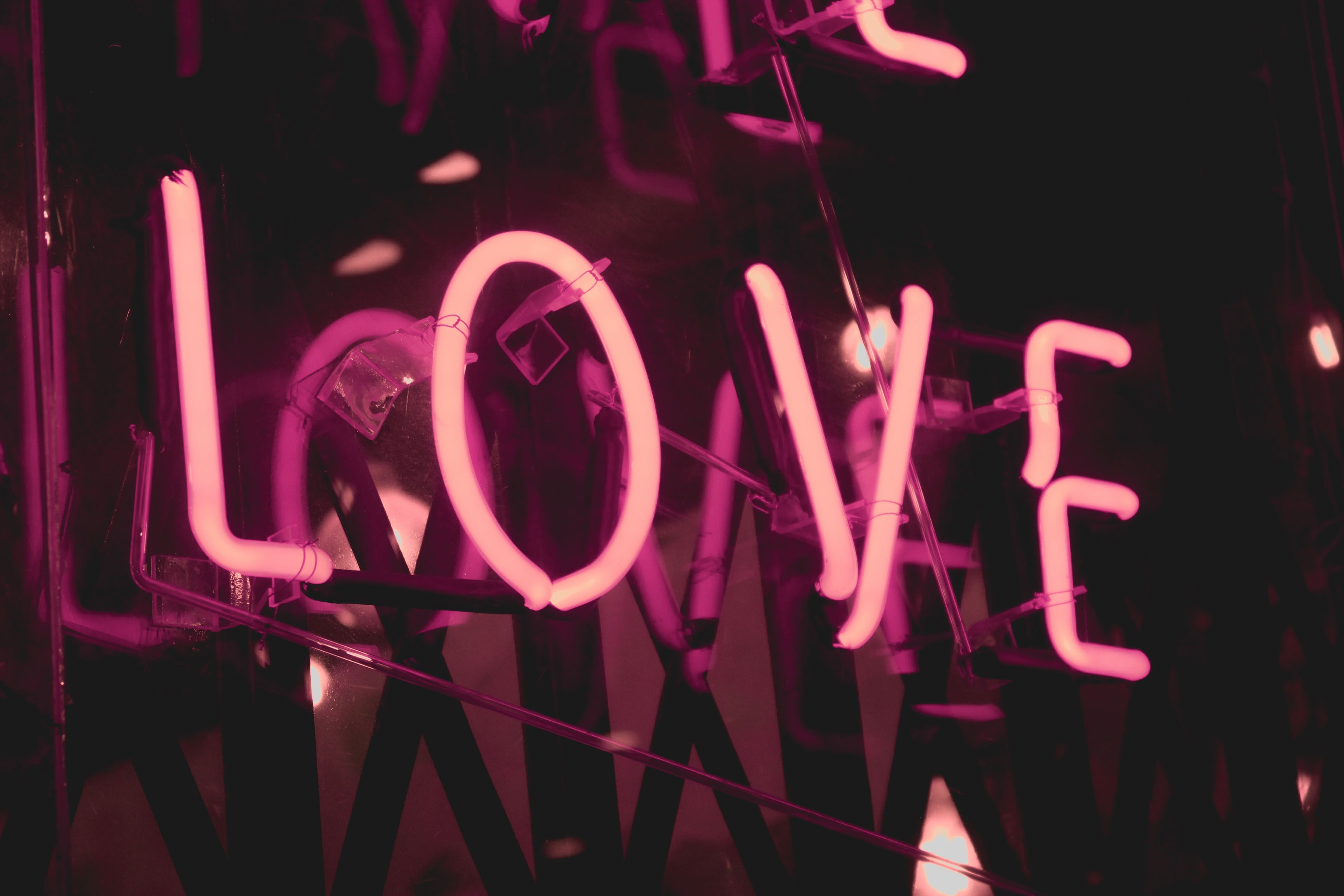 turned on pink Love neon signage