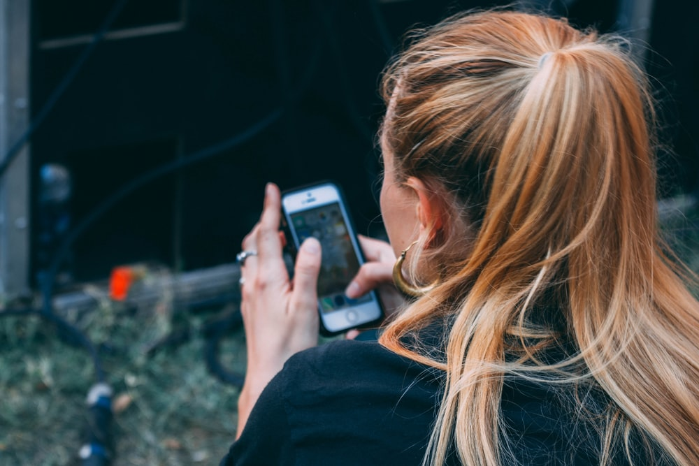 woman using iPhone outdoor