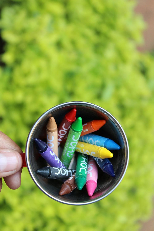 flat lay photography of crayons inside mug